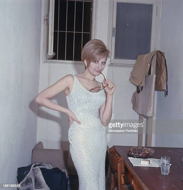 Italian singer Mina posing with her glasses between her lips 1966