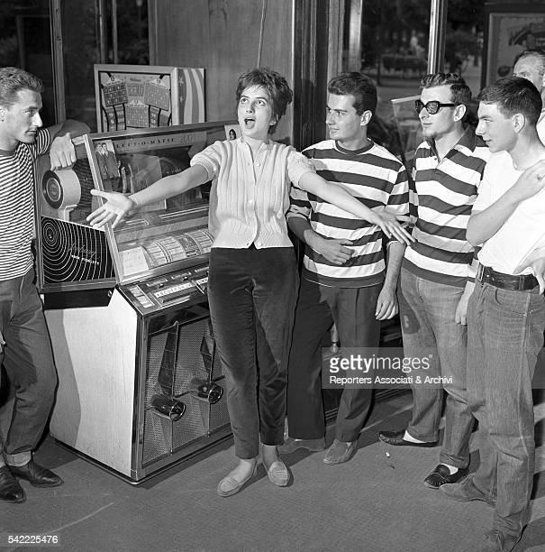 Italian singer Mina singing next to a juke box 1960