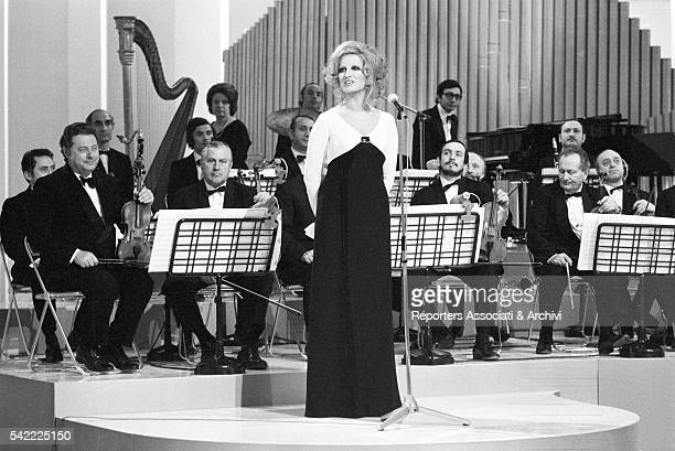 Italian singer Mina singing with an orchestra in TV show Teatro 10 1972