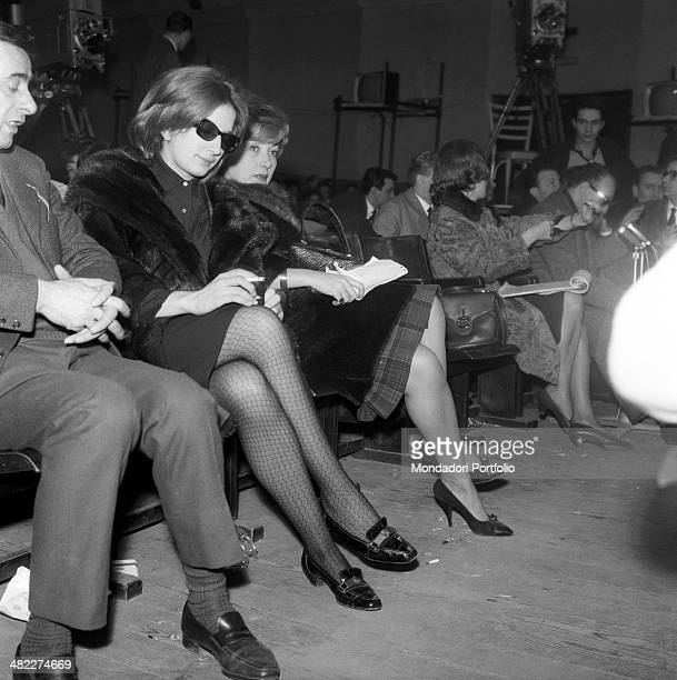 Italian singer Mina sitting in the stalls beside Italian actress Lauretta Masiero during the dress rehearsal of the TV broadcast Canzonissima Vicenza...