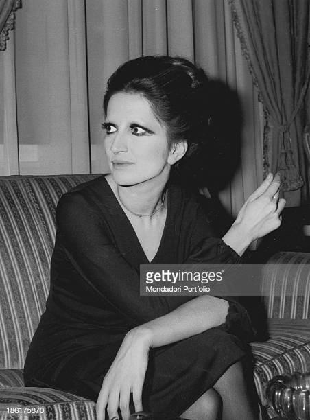 Italian singer Mina sitting on a sofa 1960s
