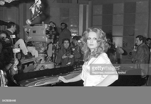 Italian singer Mina surrounded by photographers during a break in a TV studio 1972