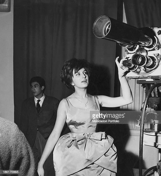Italian singer Mina touching a camera at 10th Sanremo Music Festival. Sanremo, January 1960.