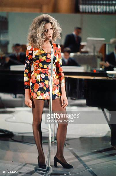Italian singer Mina very popular and famous among the public sings a song on the stage of the TV show Senza Rete hosted by Enrico Simonetti she wears...