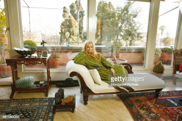 Italian singer Patty Pravo relaxing on a sofa in her house in Rome Rome 1990s