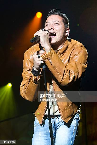 Italian singer Piero Esteriore performs live in support of Andreas Gabalier during a concert at the Tempodrom on October 11 2013 in Berlin Germany