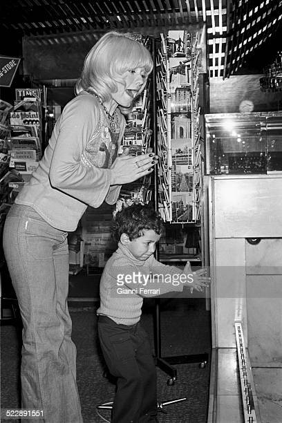 Italian singer Rita Pavone buying souvenirs with his son 10th May 1973 Madrid Spain
