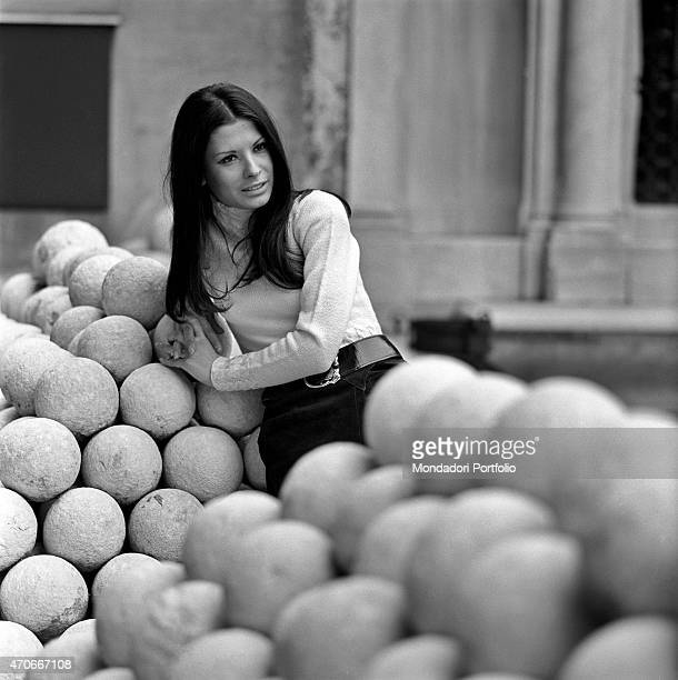 Italian singer Rosanna Fratello poses leaning herself against a pile of cannonballs she started her career at a tender age then became famous thanks...