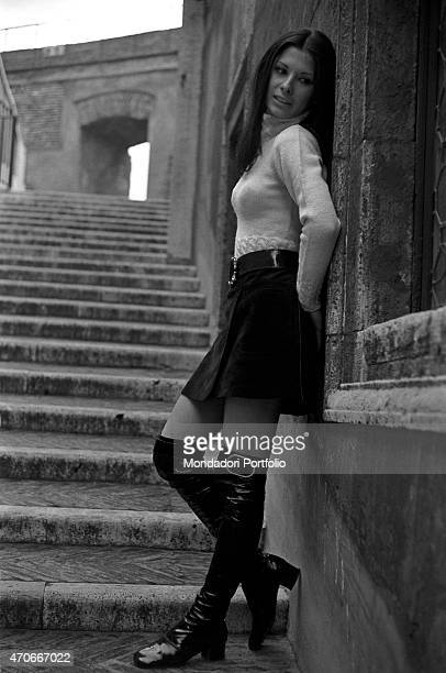 Italian singer Rosanna Fratello poses on a flight of steps leaning herself against a wall she started her career at a tender age then became famous...