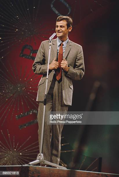 Italian singer Sergio Endrigo performs the song 'Marianne' on stage in the Eurovision Song Contest at the Royal Albert Hall in London on 6th April...