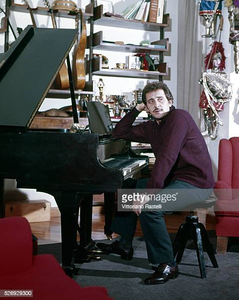 Italian singer songwriter and actor Domenico Modugno at his home in Rome near Ponte Milvio