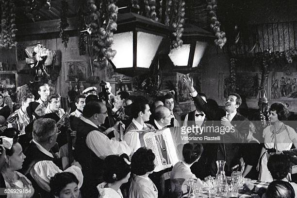 Italian singer songwriter and actor Domenico Modugno performing in the restaurant Meo Patacca in Rome