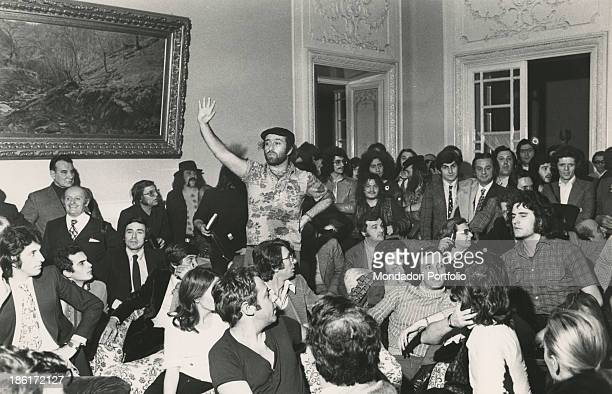 Italian singer songwriter and musician Lucio Dalla raising his arm to speak during a meeting with Italian actor and comedian Paolo Villaggio Italian...