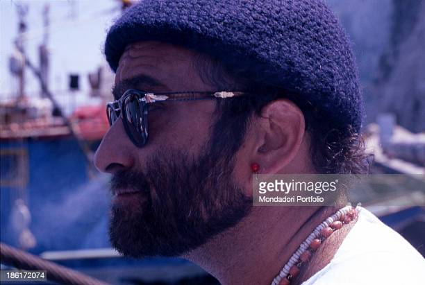 Italian singer, songwriter and musician Lucio Dalla waiting to perform in a concert wearing his typical beret on his head. 1978.