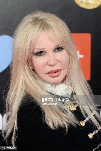 Italian singer Spagna attends the Shangay Pride Madrid Photocall 2014 at Vicente Calderon Stadium on July 4 2014 in Madrid Spain