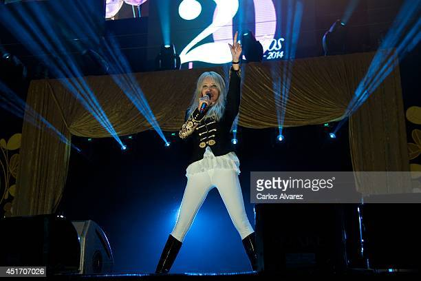 Italian singer Spagna performs on stage during the Shangay Pride concert at the Vicente Calderon stadium on July 4 2014 in Madrid Spain