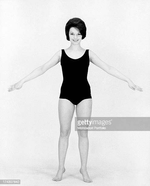 Italian singer Stella Dizzy working out with open arms 1960s
