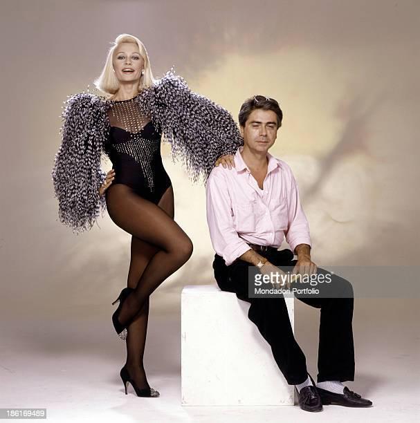Italian singer TV presenter showgirl and dancer Raffaella Carrà wearing a dress designed by Italian fashion designer Rocco Barocco on a photo set...