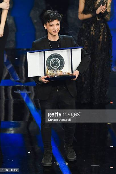 italian singer Ultimo winner of Nuove Proposte category of the 68th Italian Music Festival in Sanremo poses with his trophy at the Ariston theatre...