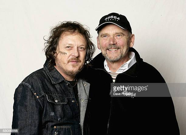 Italian singer Zucchero and manager of Queen Jim Beach pose in the studio at the 46664 Arctic concert at Fyllingen on June 11 2005 in Tromso Norway...