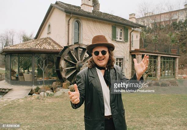 Italian singer Zucchero Fornacieri near a renovated farmhouse on the grounds of his estate in Pontremoli