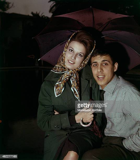 Italian singers Adriano Celentano and Mina posing under the umbrella at the 11th Sanremo Music Festival Sanremo 1961