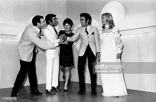 Italian singers Al Bano Mario Tessuto and Orietta Berti joking with Italian announcer and actress Gabriella Farinon and Italian TV presenter Pippo...