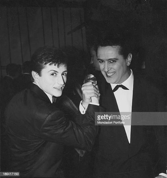 Italian singers Emilio Pericoli and Tony Renis shaking hands during the 13th Sanremo Music Festival They both will win the Festival with the song Uno...