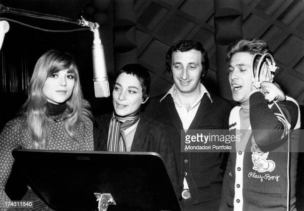 Italian singers Marina Occhiena, Angela Brambati, Angelo Sotgiu and Franco Gatti trying a song in a recording studio. They form the band Ricchi e...