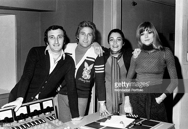Italian singers Marina Occhiena Angela Brambati Angelo Sotgiu and Franco Gatti posing in a recording studio They form the band Ricchi e Poveri Milan...