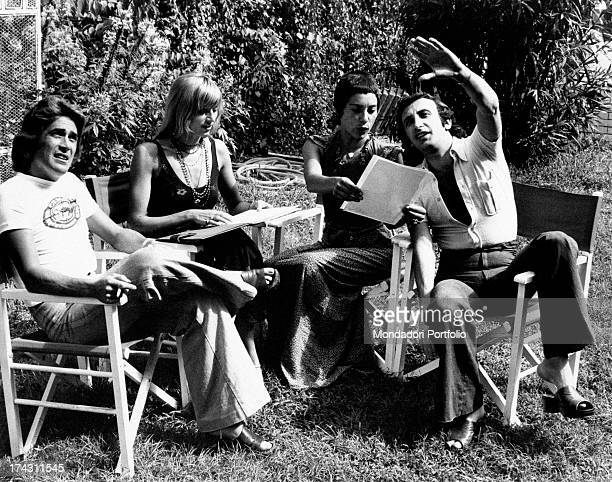 Italian singers Marina Occhiena Angela Brambati Angelo Sotgiu and Franco Gatti sitting in a garden and trying singing a song They form the band...