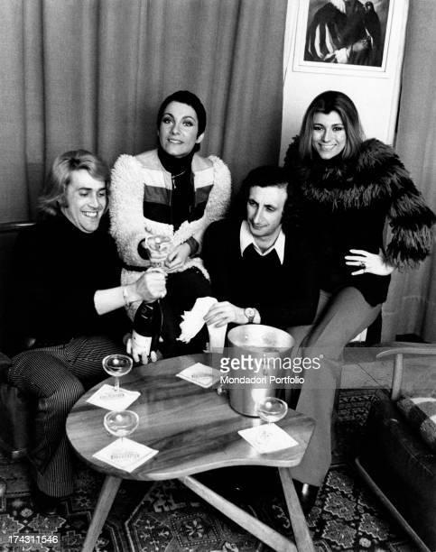 Italian singers Marina Occhiena Angela Brambati Angelo Sotgiu and Franco Gatti celebrating with a bottle of champagne They form the band Ricchi e...