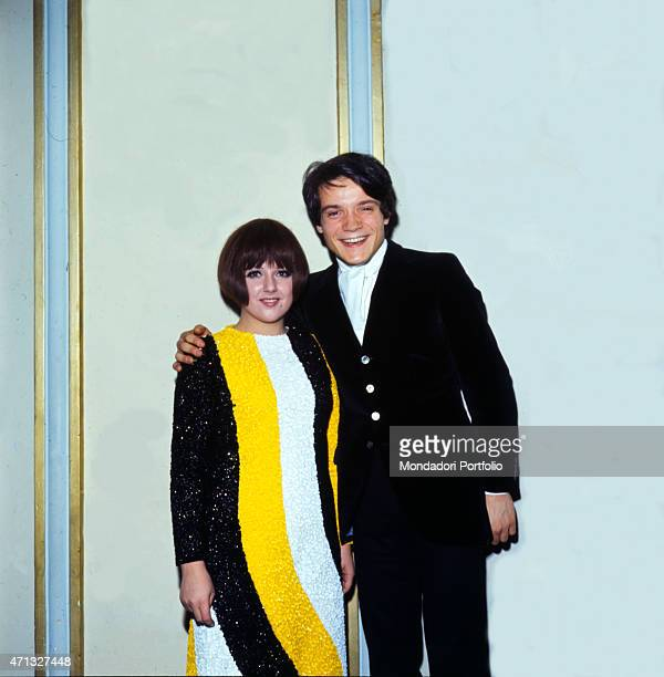 Italian singers Orietta Berti and Massimo Ranieri posing smiling for a photo shooting at the 19th Sanremo Music Festival where they sings together...