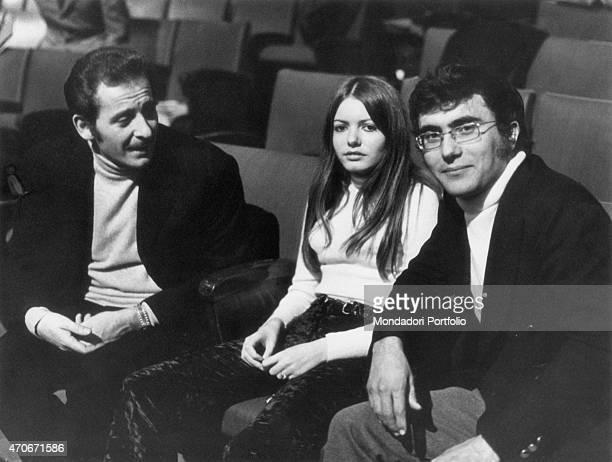 'Italian singersongwriter actor and director Domenico Modugno sitting beside Italian singersongwriter Al Bano and American singer actress and painter...
