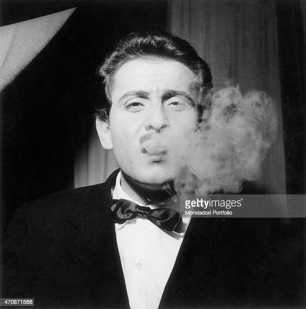 'Italian singersongwriter actor and director Domenico Modugno smoking Italy 1950s '