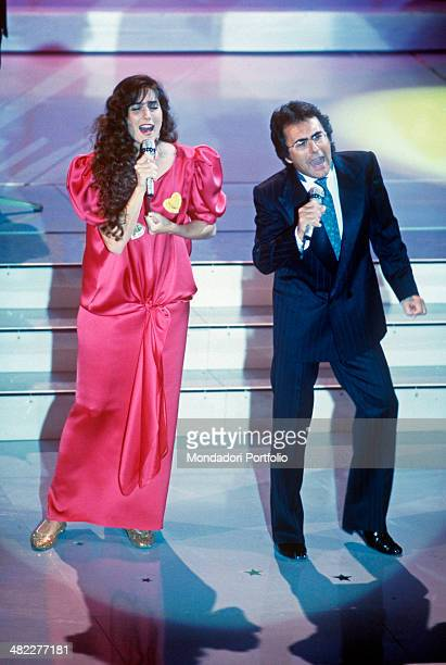 Italian singersongwriter Al Bano and American singer and actress Romina Power performing the song Cara terra mia at the 39th Sanremo Music Festival...