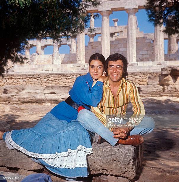 Italian singersongwriter Al Bano and American singer and actress Romina Power posing smiling at the Athenian Acropolis Athens 1970s