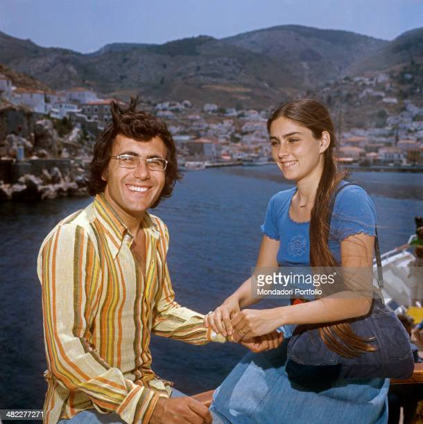 Italian singersongwriter Al Bano and American singer and actress Romina Power posing smiling during a holiday in Greece Greece 1970s