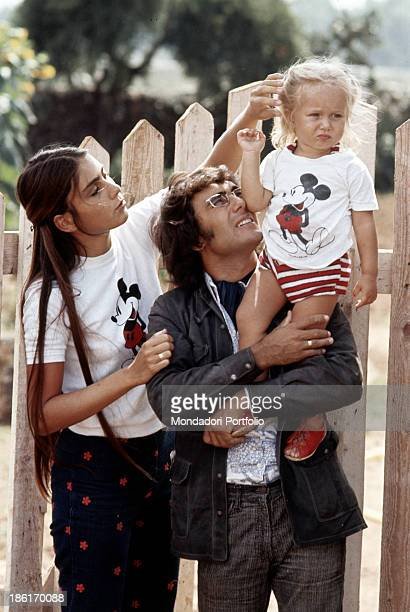 Italian singersongwriter Al Bano with his wife Americanborn Italian singer and actress Romina Power holding their daughter Ylenia Carrisi in his arms...