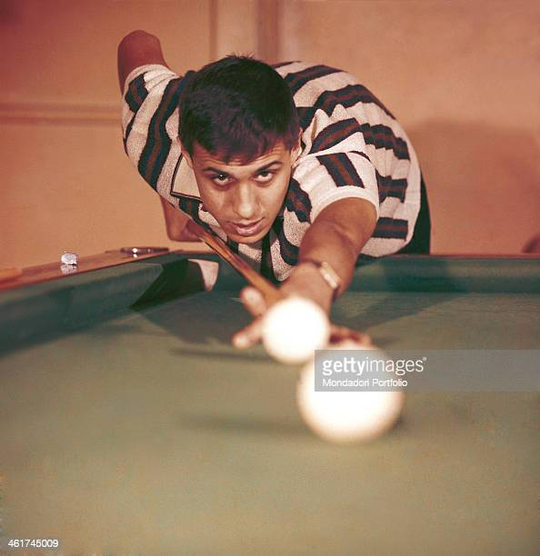 Italian singersongwriter and actor Adriano Celentano playing billiards Italy 1962