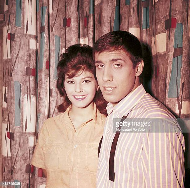 Italian singersongwriter and actor Adriano Celentano posing beside his future wife Italian actress singer and record producer Claudia Mori Italy 1962