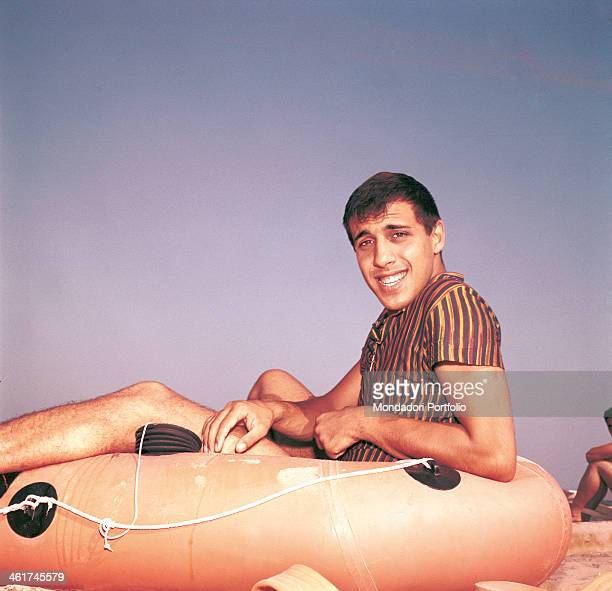 Italian singersongwriter and actor Adriano Celentano sitting in a rubber boat Italy 1962