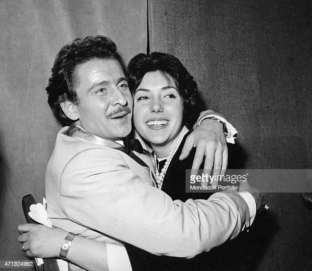 Italian singersongwriter and actor Domenico Modugno hugging his wife and Italian actress Franca Gandolfi 1950s