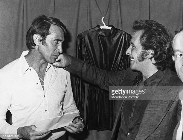 Italian singersongwriter and actor Domenico Modugno smiling in front of Italian actor and TV presenter Walter Chiari September 1970