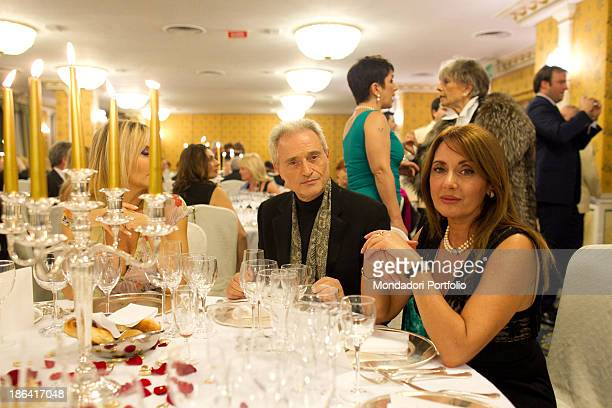 Italian singersongwriter and composer Amedeo Minghi sitting beside his wife Elena Paladino during the reception at the hotel Parco dei Principi...