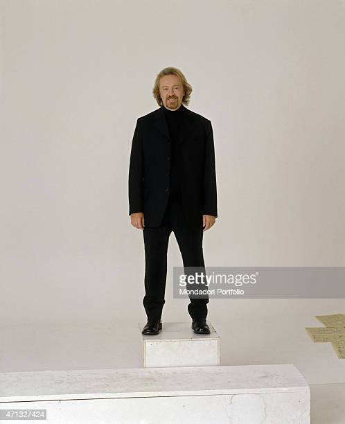 Italian singer-songwriter and guitarist Umberto Tozzi balancing on a footboard. Italy, 1997