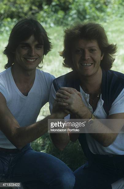 Italian singersongwriter and guitarist Umberto Tozzi holding Spanishborn Italian singer and TV presenter Miguel Bos's hand 1987