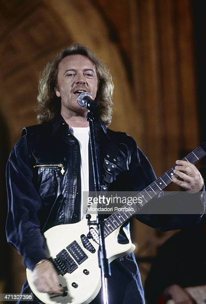 Italian singer-songwriter and guitarist Umberto Tozzi performing at Festivalbar with the song Io muoio di te. Italy, 1994