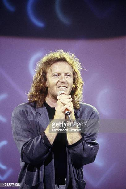 Italian singer-songwriter and guitarist Umberto Tozzi performing on the TV show La Corrida - Dilettanti allo sbaraglio. Italy, 1988