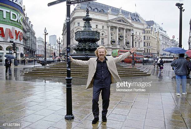 Italian singer-songwriter and guitarist Umberto Tozzi posing in Piccadilly Circus, in front of the fountain called Shaftesbury Memorial Fountain. On...